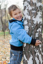 Cheerful Boy Hugging Birches, Autumn Park Stock Photography - 21747292