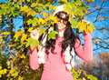 Happy Woman With Foliage In Autumn Royalty Free Stock Photo - 21750245