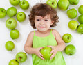 Adorable Little Girl Lying With Green Apples Stock Image - 21797471