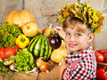 Child With Vegetable On Kitchen. Stock Photo - 21842370