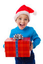 Laughing Boy In Santa Hat With Red Box Royalty Free Stock Images - 21851139