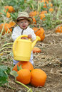 Boy With A Watering Can Stock Image - 21852971
