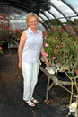 Woman In Greenhouse Royalty Free Stock Image - 2198626