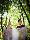 Young Couple Looking At Map During Trek Stock Images - 21925694