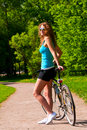 Woman With Bicycle Royalty Free Stock Images - 21927079