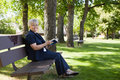 Woman Reading Book In A Park Royalty Free Stock Image - 21945136