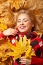 Young Woman With Autumn Leaves Stock Image - 21964771