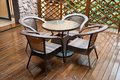 Wicker Chairs And Table On Deck Royalty Free Stock Images - 21966829