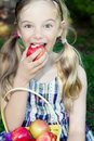 Funny Girl Eating Apple Royalty Free Stock Photo - 21983485