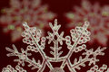 Christmas Snow Flake On Red Royalty Free Stock Image - 22077396