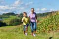 Family Outdoors Is Running On A Meadow Royalty Free Stock Image - 22212046