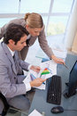 Portrait Of A Focused Business Team Looking At A Graph Royalty Free Stock Images - 22235849