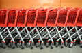 Red Supermarket Trolleys Stock Photography - 22344722