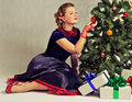 Woman Next To Christmas Tree Royalty Free Stock Images - 22379069