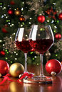 Glasses Of Red Wine In Front Of Christmas Tree Royalty Free Stock Photography - 22393237