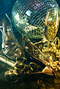Silver Party Shoes On Floor With Champagne Glass Royalty Free Stock Photography - 22393247