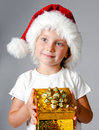 Girl With Gifts In Santa Hat Royalty Free Stock Photo - 22424985