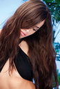 Woman With Long Hair In Front Of A Palm Tree Stock Photography - 22459022