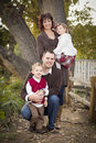 Attractive Parents And Children Portrait In Park Stock Photo - 22461580