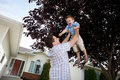 Father Lifting Son In Air Stock Image - 22514901