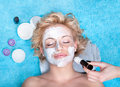 Young Women Getting Facial Mask. Royalty Free Stock Images - 22533569
