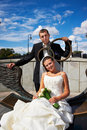 Bride And Groom On Bronze Bench Stock Photo - 22578630