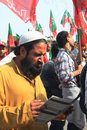 PTI Supporter Reads Party Literature Outside Rally Royalty Free Stock Photography - 22590177