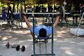 Man Lifting Weights In Lumphini Park Stock Photography - 22598412