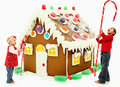 Children Building Giant Christmas Gingerbread Hous Royalty Free Stock Photo - 22631195