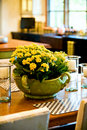Fresh Flower Arrangement On The Dining Room Table Royalty Free Stock Photo - 22651295