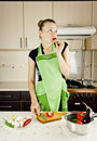Young Woman In The Kitchen Royalty Free Stock Image - 22685876