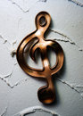 Warped Artistic Copper Treble Clef Royalty Free Stock Images - 22702019