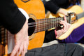 Man Hands Playing The Spanish Guitar Stock Images - 22723494