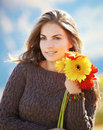 Young Woman With Flowers Stock Photo - 22735980