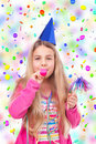 Girl With Party Hat And Party Horn Blower Stock Image - 22853811