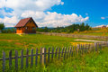 Small Country House, Meadow And Wooden Fence Royalty Free Stock Photo - 22869545