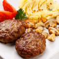 Fried Steaks With Potatoes And Fried Mushrooms Stock Image - 22906671
