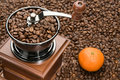 Old Coffee Grinder And Orange Royalty Free Stock Photography - 22914677