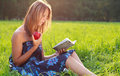 Beautiful Woman Reading Book With Apple In Hand Stock Photo - 22921820