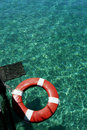 Lifesaver On  Green Water Surface Stock Photos - 22985153