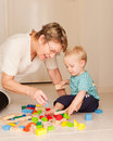 A Grandmother Or Nanny Plays With A Little Boy Royalty Free Stock Photo - 23002855