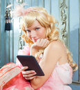 Blond Fashion Princess Woman Reading Ebook Tablet Royalty Free Stock Photos - 23036138