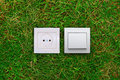 Electric Outlet And Light Switch On A Grass Royalty Free Stock Photos - 23145298