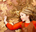 Autumn Fall Little Blond Girl On Dried Tree Leaves Royalty Free Stock Images - 23148089