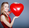 Girl With Red Heart Royalty Free Stock Image - 23148346