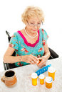 Disabled Woman Takes Medicine Stock Images - 23178964
