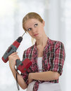 Funny   Girl With A Drill Drills Head Royalty Free Stock Photography - 23196387