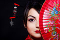 Woman In Asian Costume With Red Asian Fan Stock Photo - 23204030