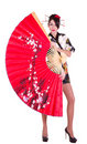 Woman In Asian Costume With Red Asian Fan Stock Photography - 23204522