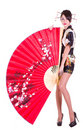 Woman In Asian Costume With Red Asian Fan Stock Photos - 23204583